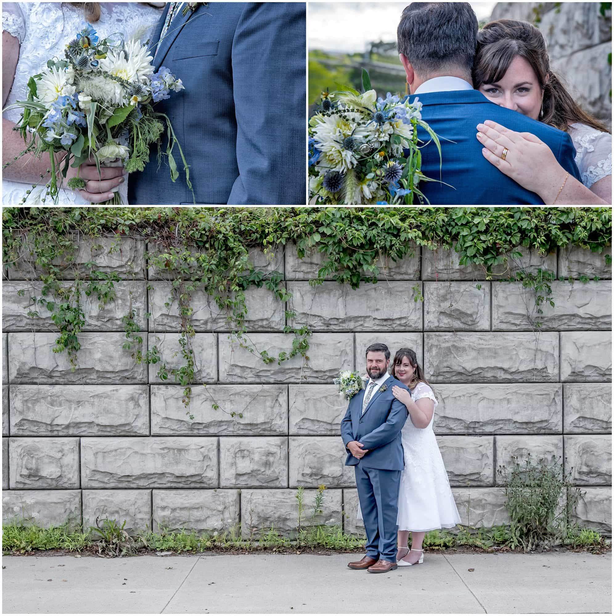 The bride and groom pose for wedding photos infront of a stone wall with hanging green leafy veins by the Best Western Chocolate Lake Hotel in Halifax NS.