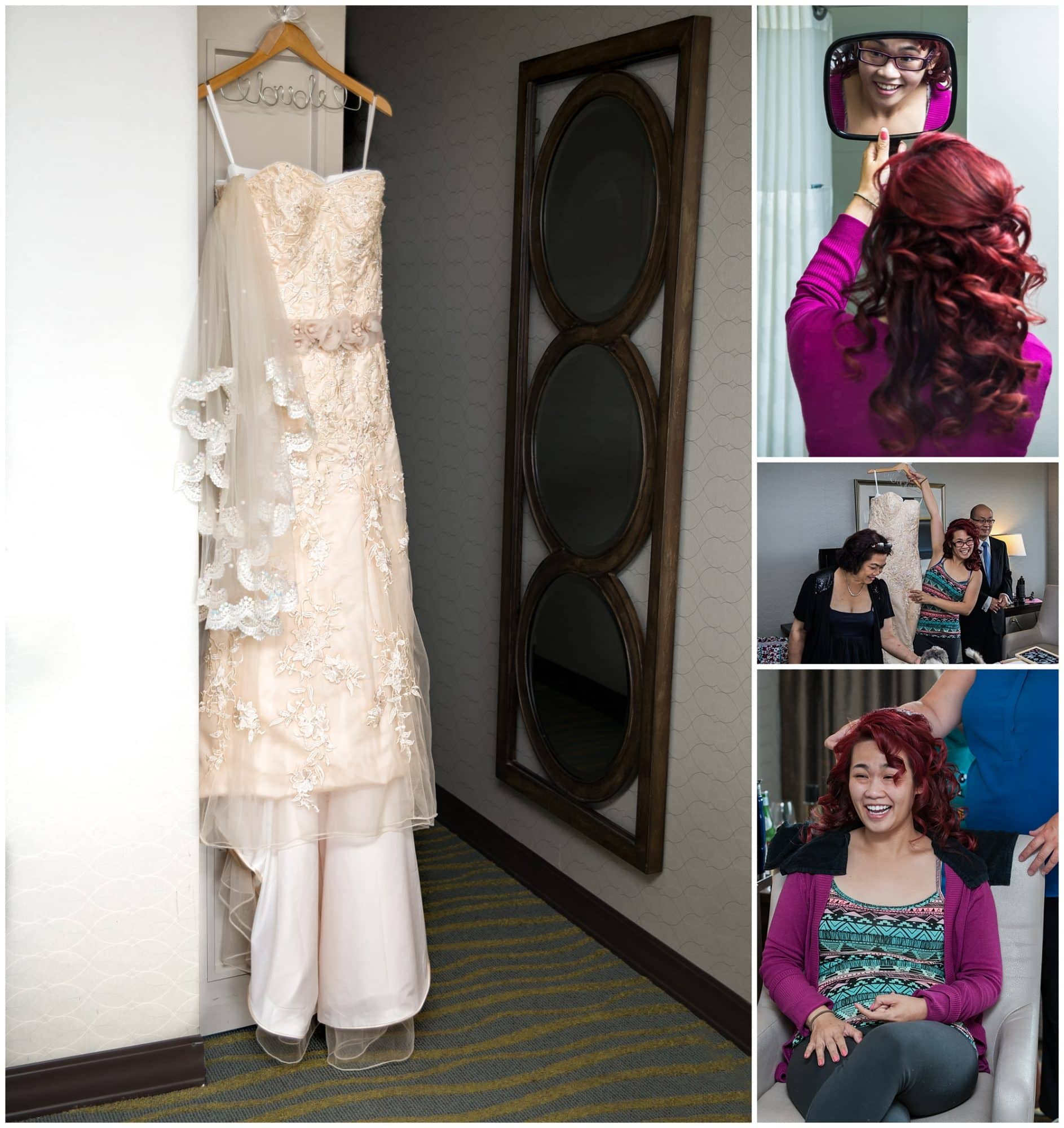 The wedding dress hangs from a door during the bride's bridal prep with her hair at the Atlantica Hotel in Halifax, NS.