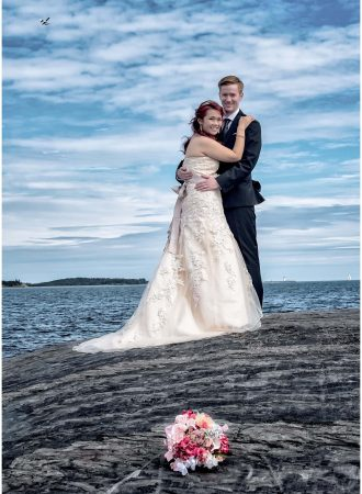 The bride and groom pose for wedding photos when a seaplane flies into view at Point Pleasant Park in Halifax, Nova Scotia.