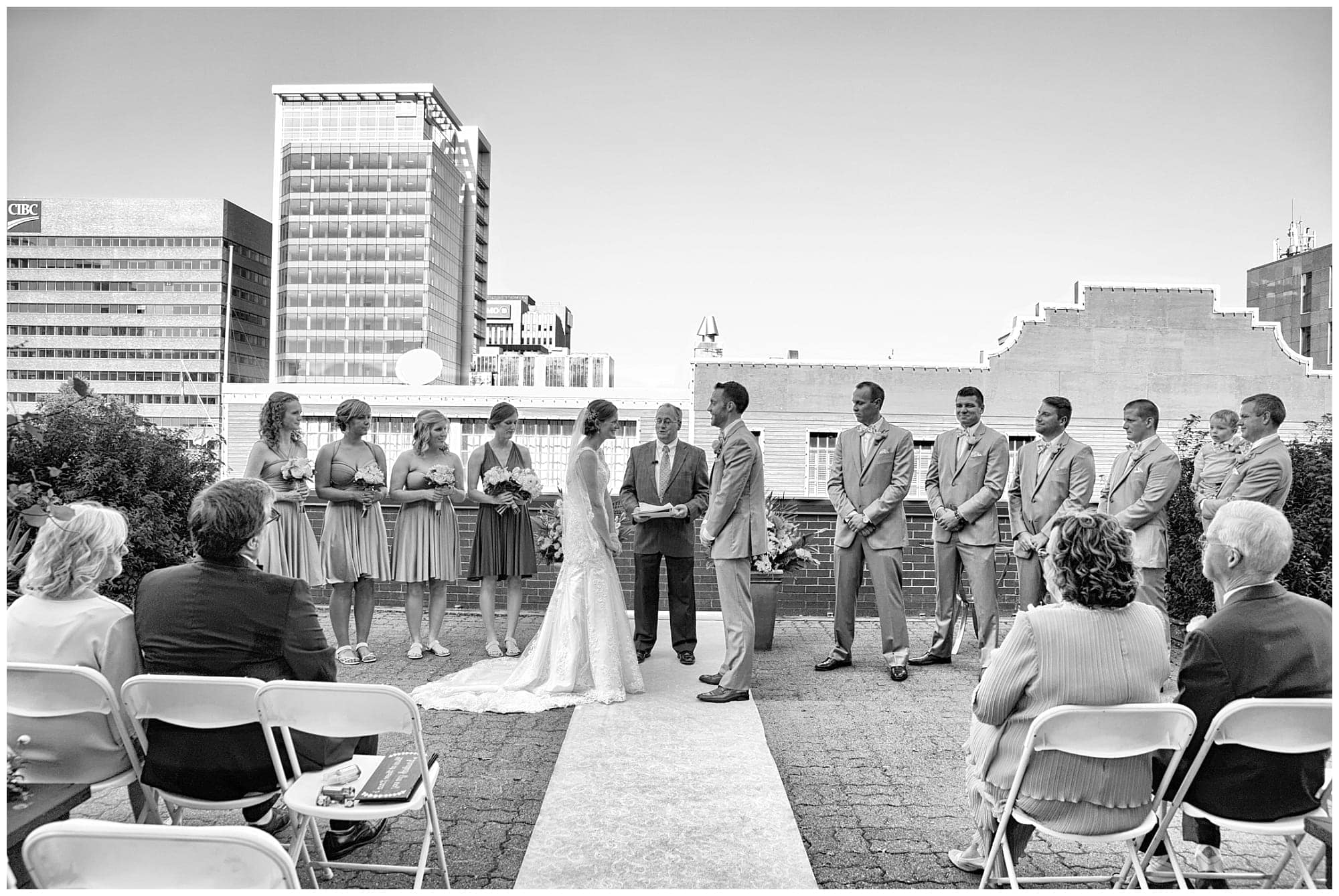 The bride and groom's wedding ceremony on the balcony at the Prince George Hotel in Halifax.