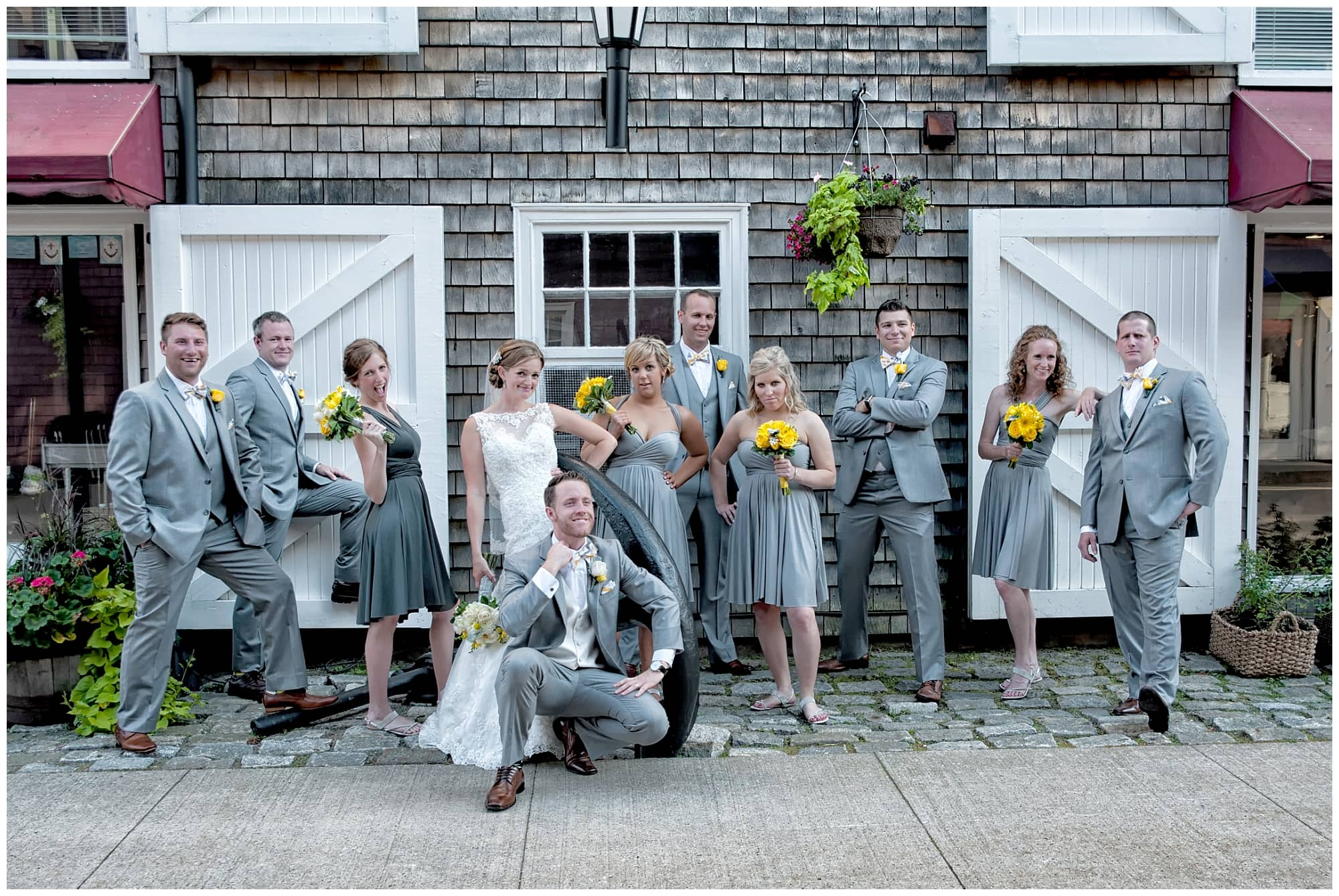 The bride and groom pose for wedding photos with their wedding party in the Historic Properties in Halifax, Nova Scotia.