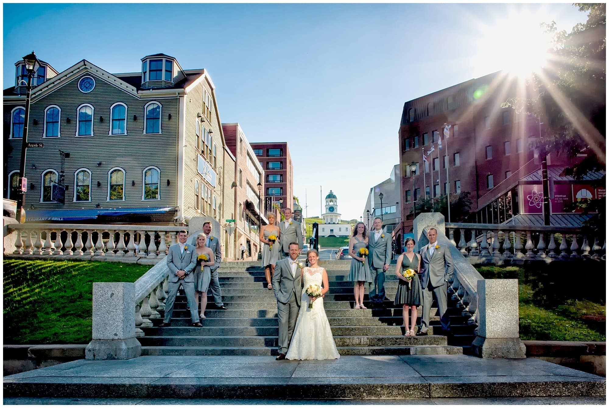 The wedding party photos with the bride and groom at sunset in the Grand Parade, Halifax NS.
