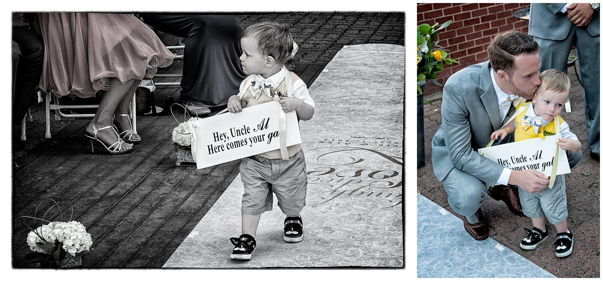 The ring bearer walks up the aisle carrying a wedding sign during a wedding at the Prince George Hotel in Halifax.