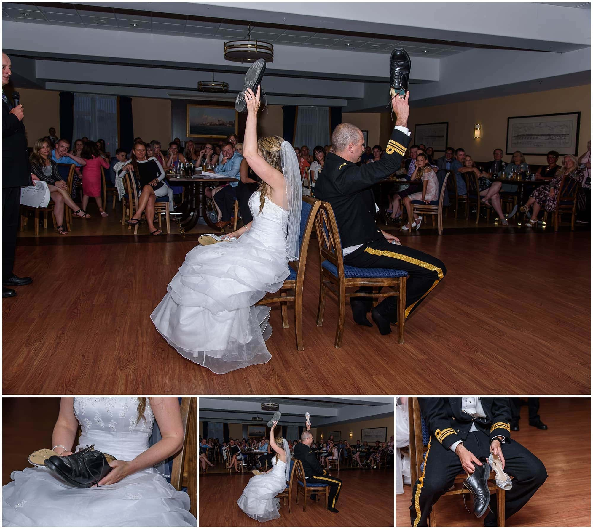 The bride and groom play the wedding shoe game during a wedding reception at Juno Tower in Halifax, NS.