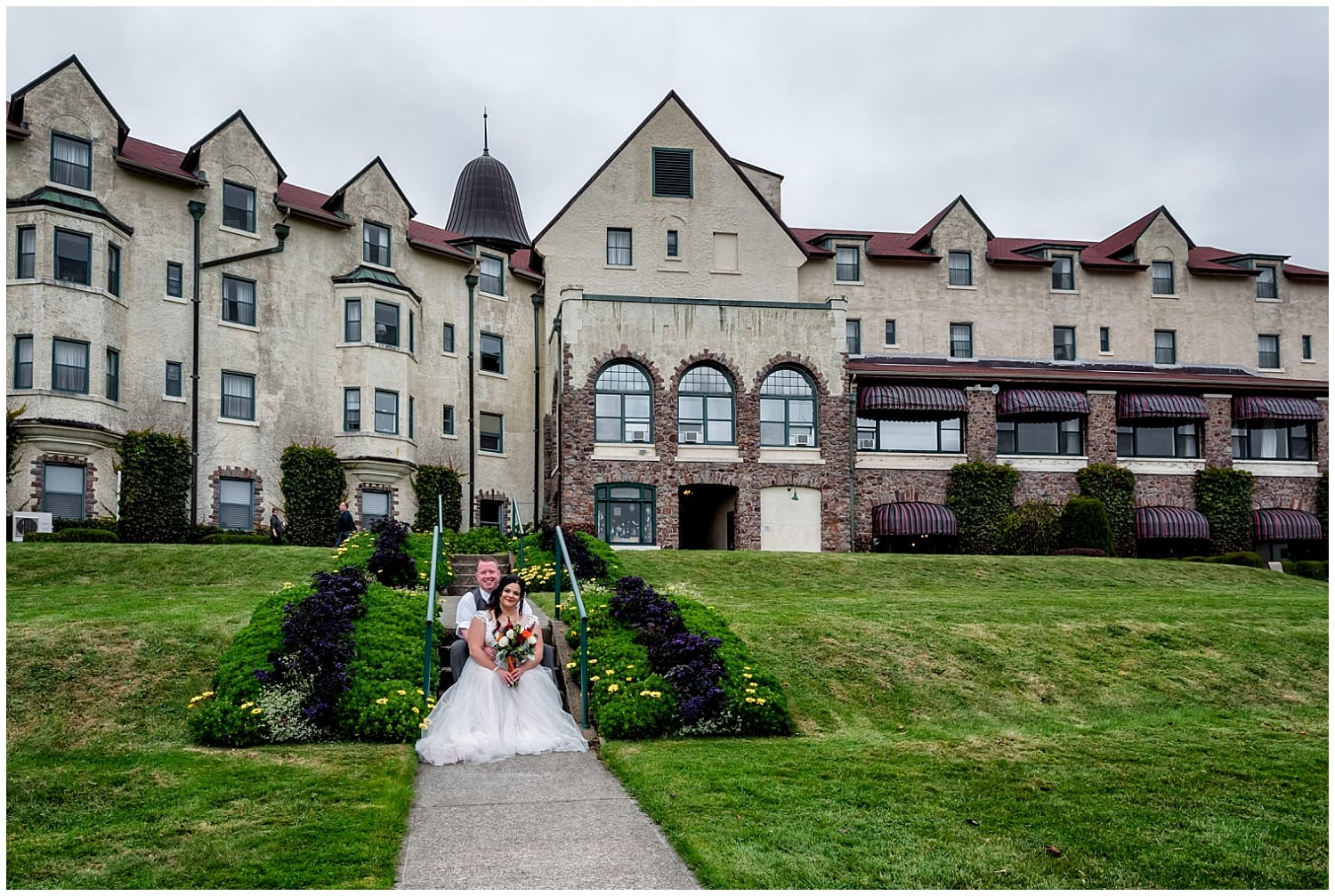 The bride and groom pose for wedding photos at the back of the Digby Pines Resort hotel in Digby Nova Scotia.