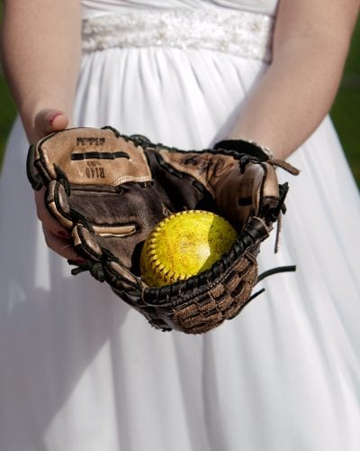 Bride with baseball and mit for a trash the dress photoshoot in Dartmouth NS.