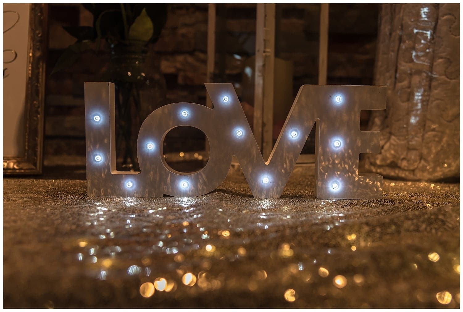 A love sign with marquee lights for weddings.