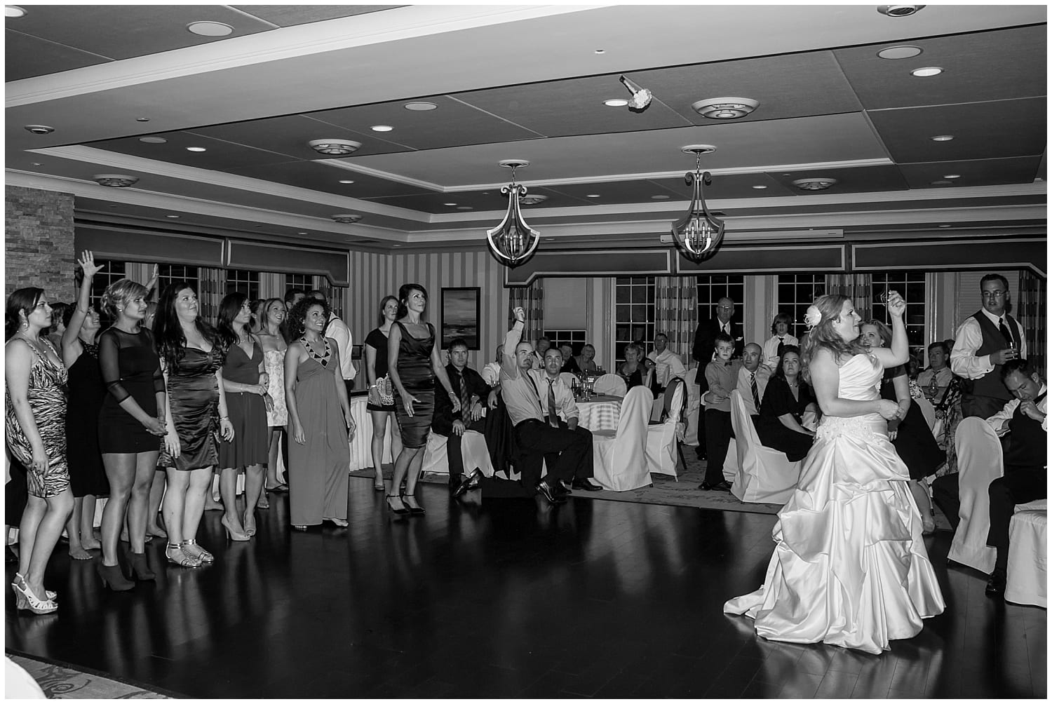 The bride tosses her bridal bouquet during her wedding reception at the Ashburn Golf Club in Halifax Nova Scotia.