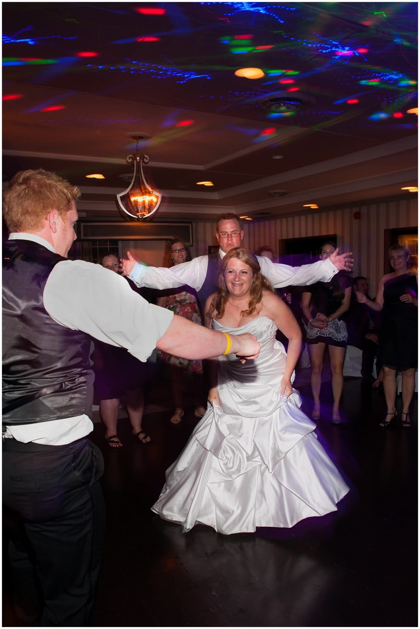 The bride and groom dancing together during their wedding reception at Ashburn Golf Club.