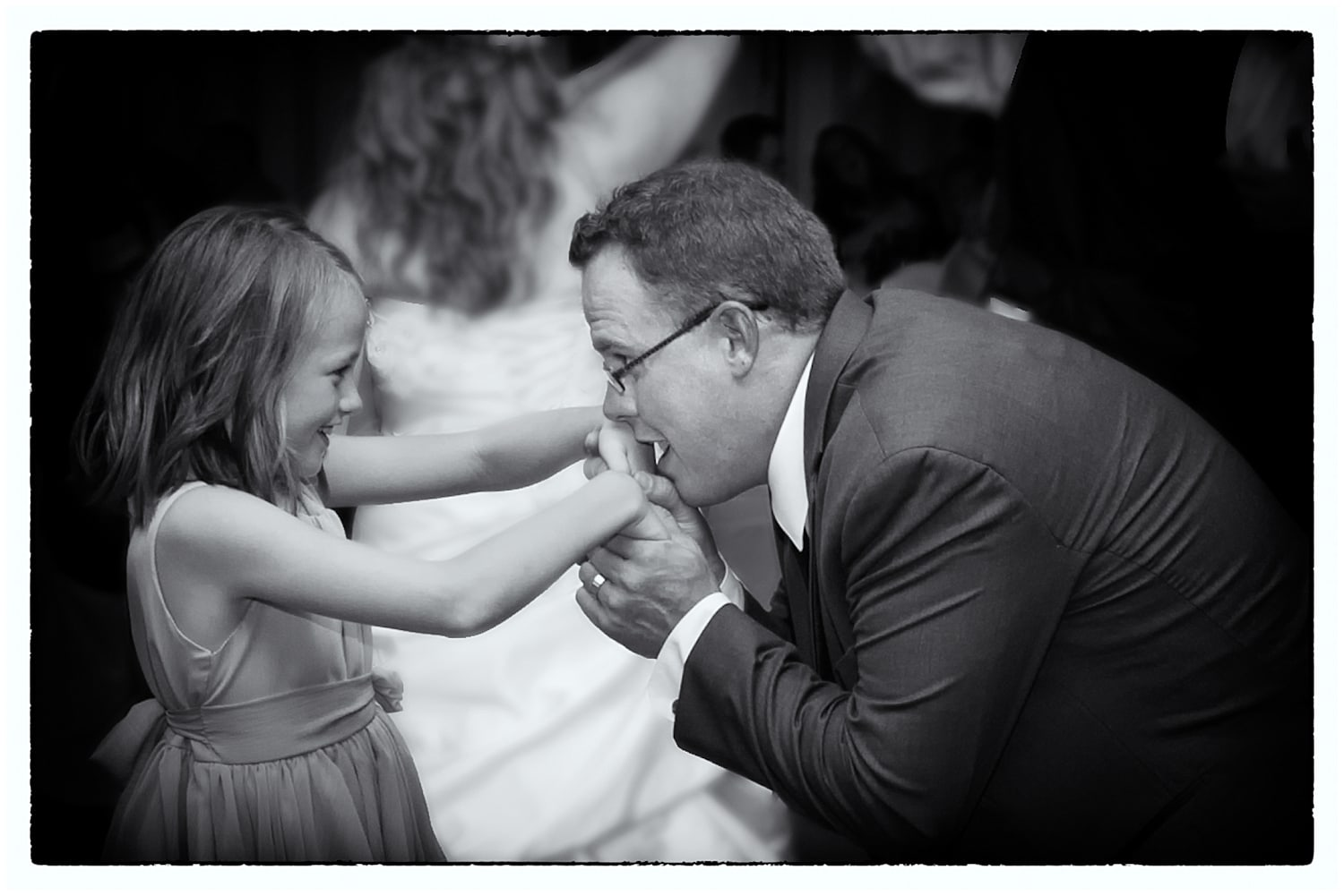 The groom dances with his daughter during his wedding reception at the Ashburn Golf Club in Halifax, NS.
