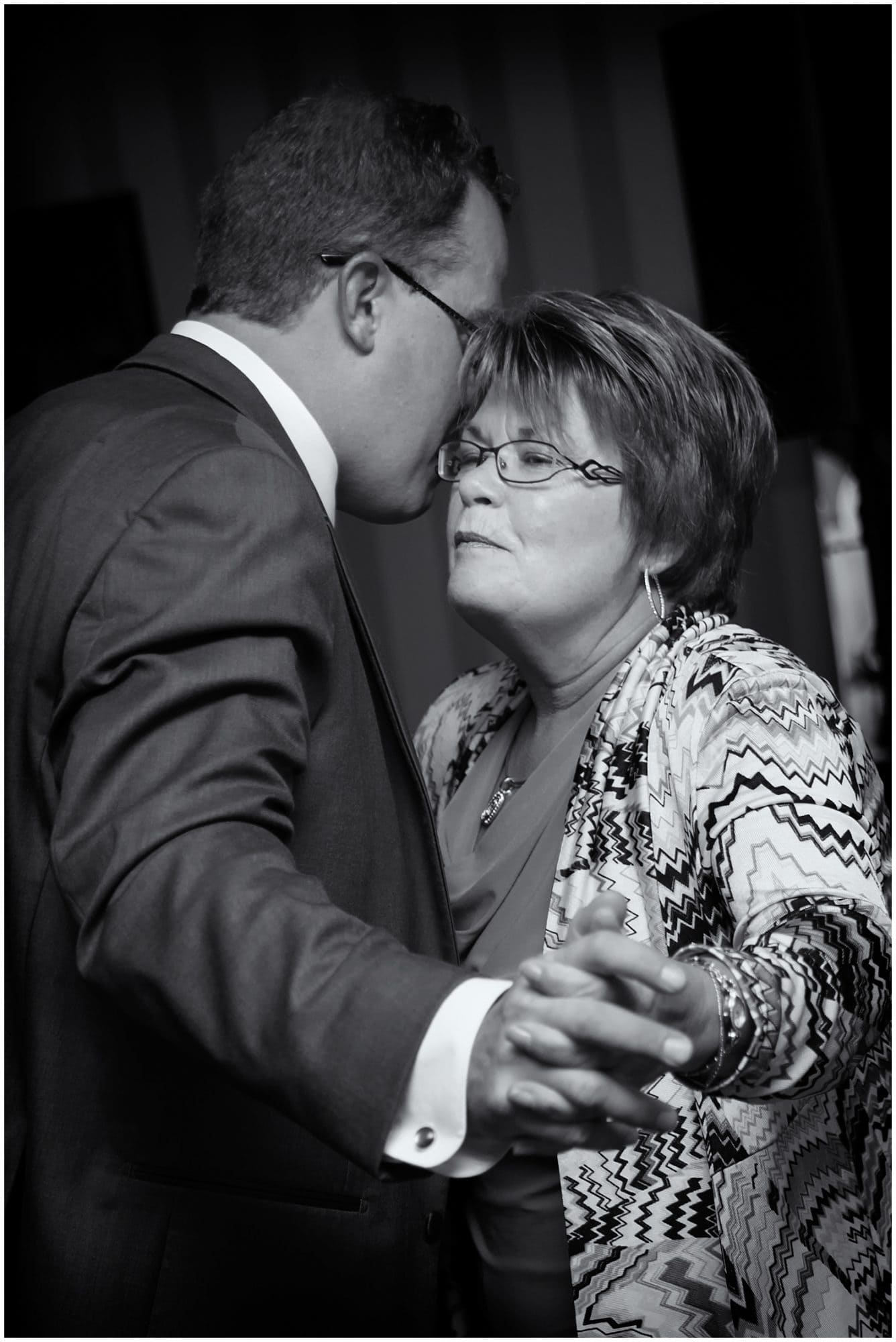 The groom dances with his mother during the parent dances at his wedding reception in the Ashburn Golf Club in Halifax.