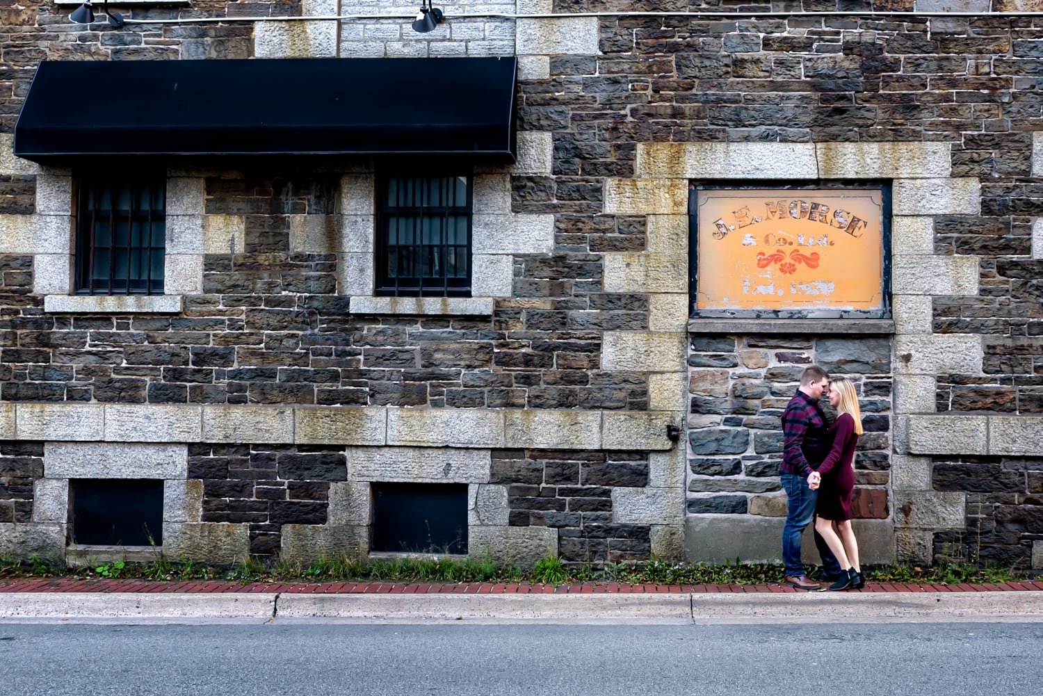 Cute couple pose for their engagement photos at the Historic Properties in Halifax, NS.