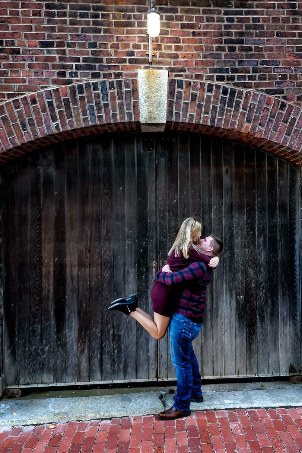 Future bride and groom pose for engagement photos in the urban area of the Halifax Waterfront.