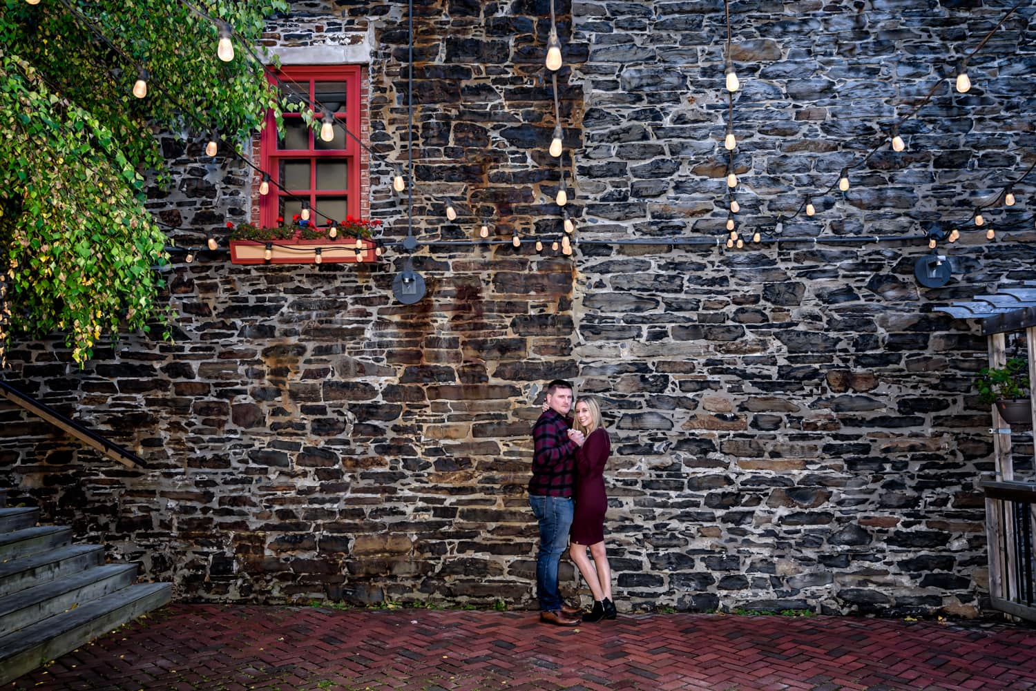 A cute couple embrace during their engagement photos in downtown Halifax, NS.