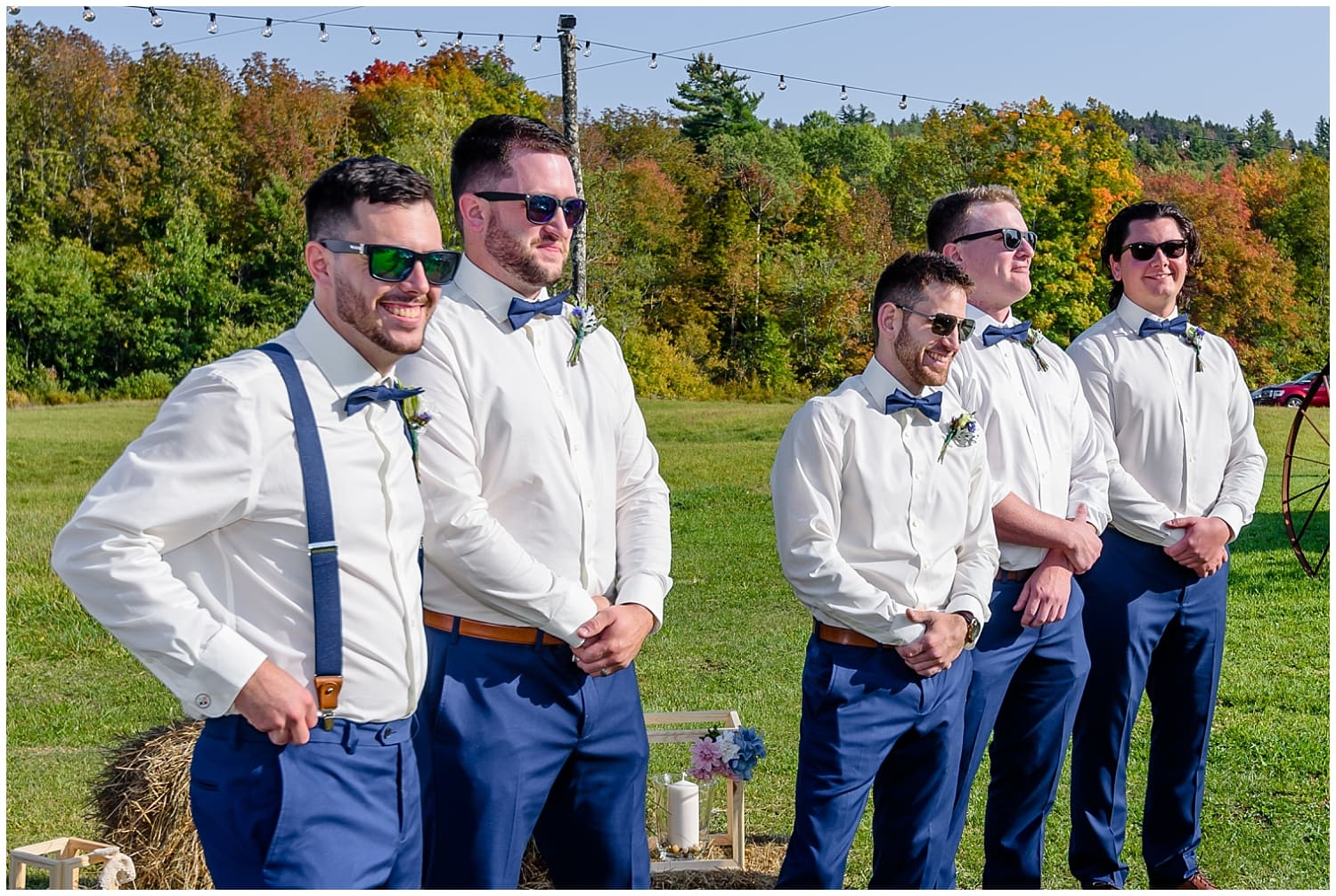 The groom stands with his groomsmen waiting for his bride to walk up the aisle during his wedding ceremony at the Barn at Sadie Belle Farm.