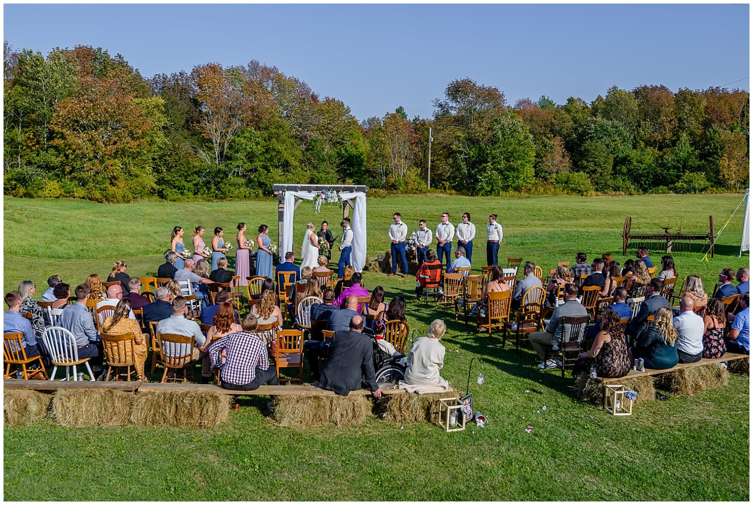 A wedding ceremony with guests at the Barn at Sadie Belle Farm in NS.