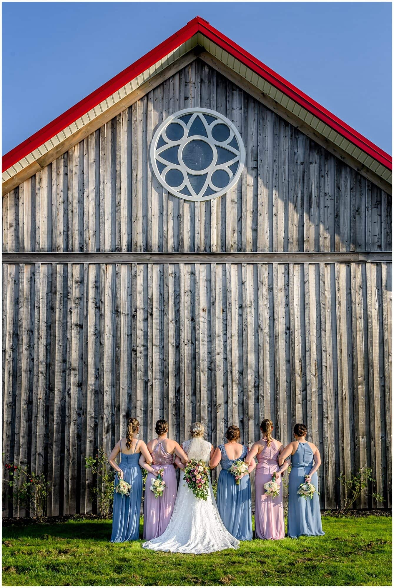 The bride with her bridesmaids pose for wedding photos at the Barn at Sadie Belle Farm in NS.