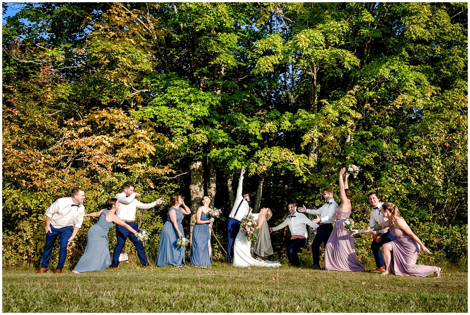 The wedding party ham it up with the bride and groom during wedding photos at the Barn at Sadie Belle Farm in Hantsport NS.
