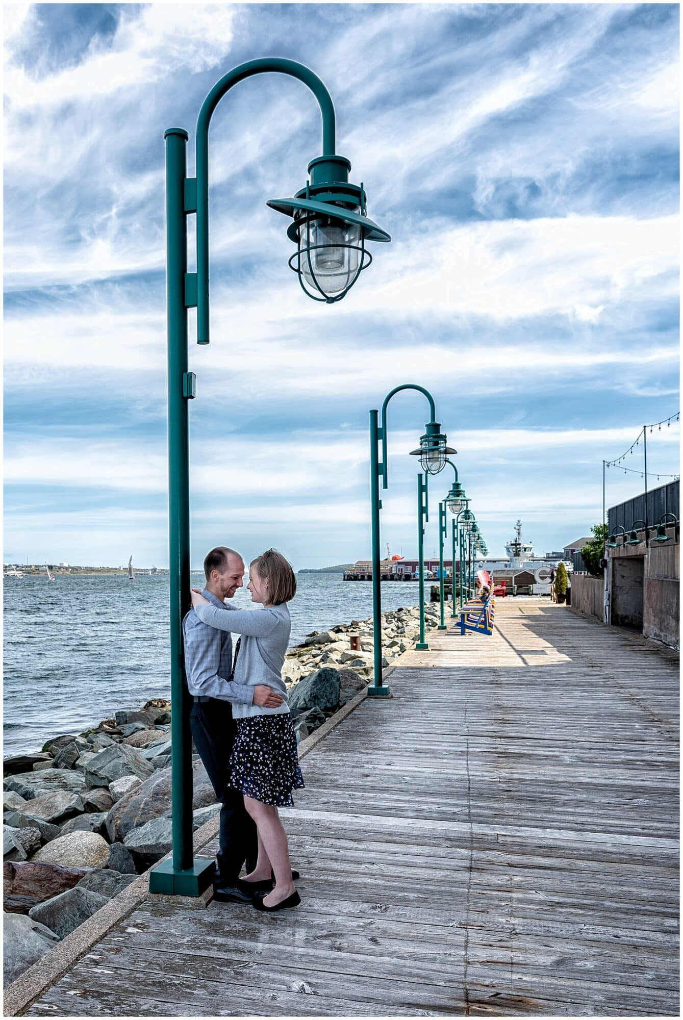 A newly engaged couple embrace and gaze at each other during their engagement photos at the Historic Properties in Halifax NS.