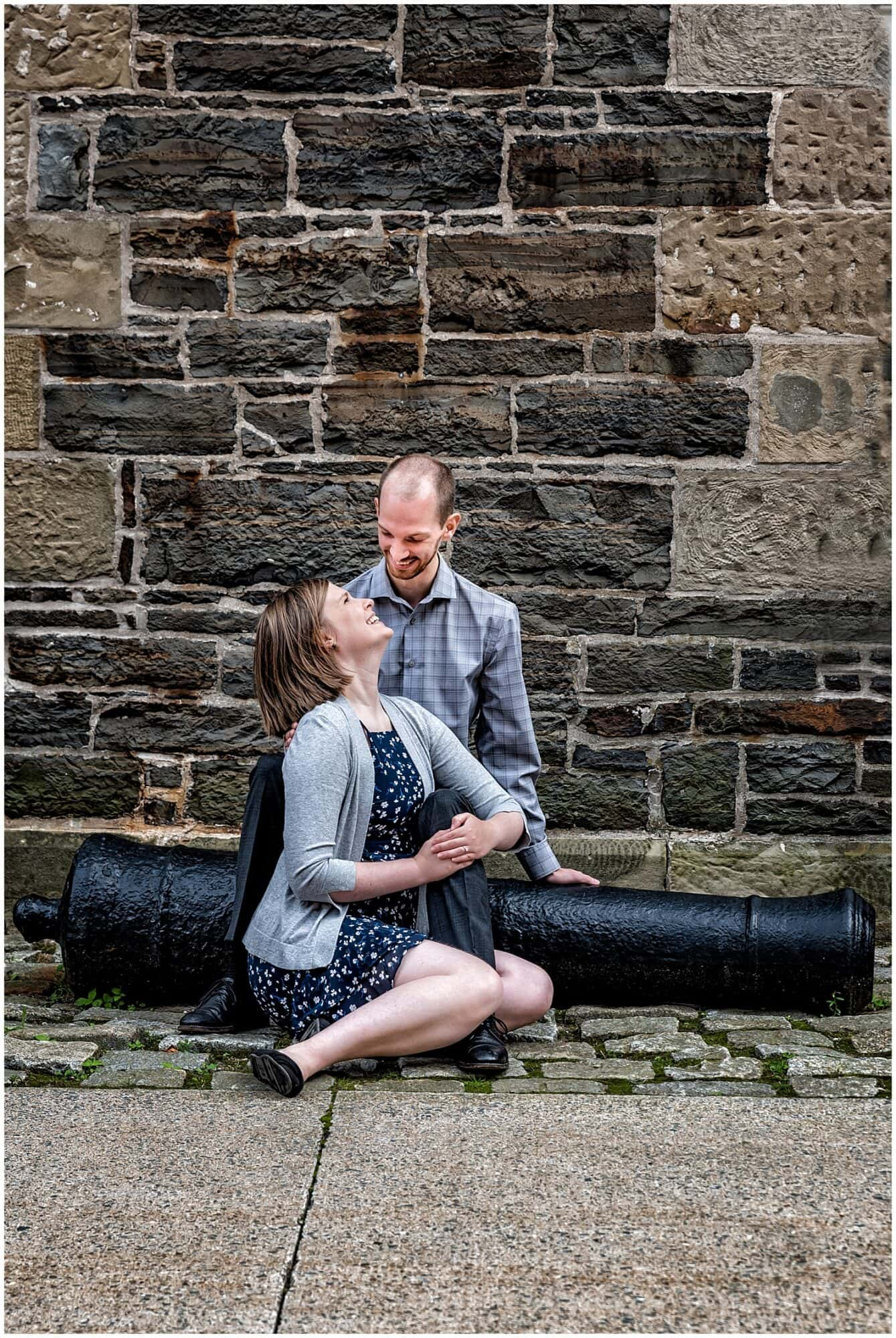 A couple in love gaze at each other during their engagement photos at the Historic Properties in Halifax NS.