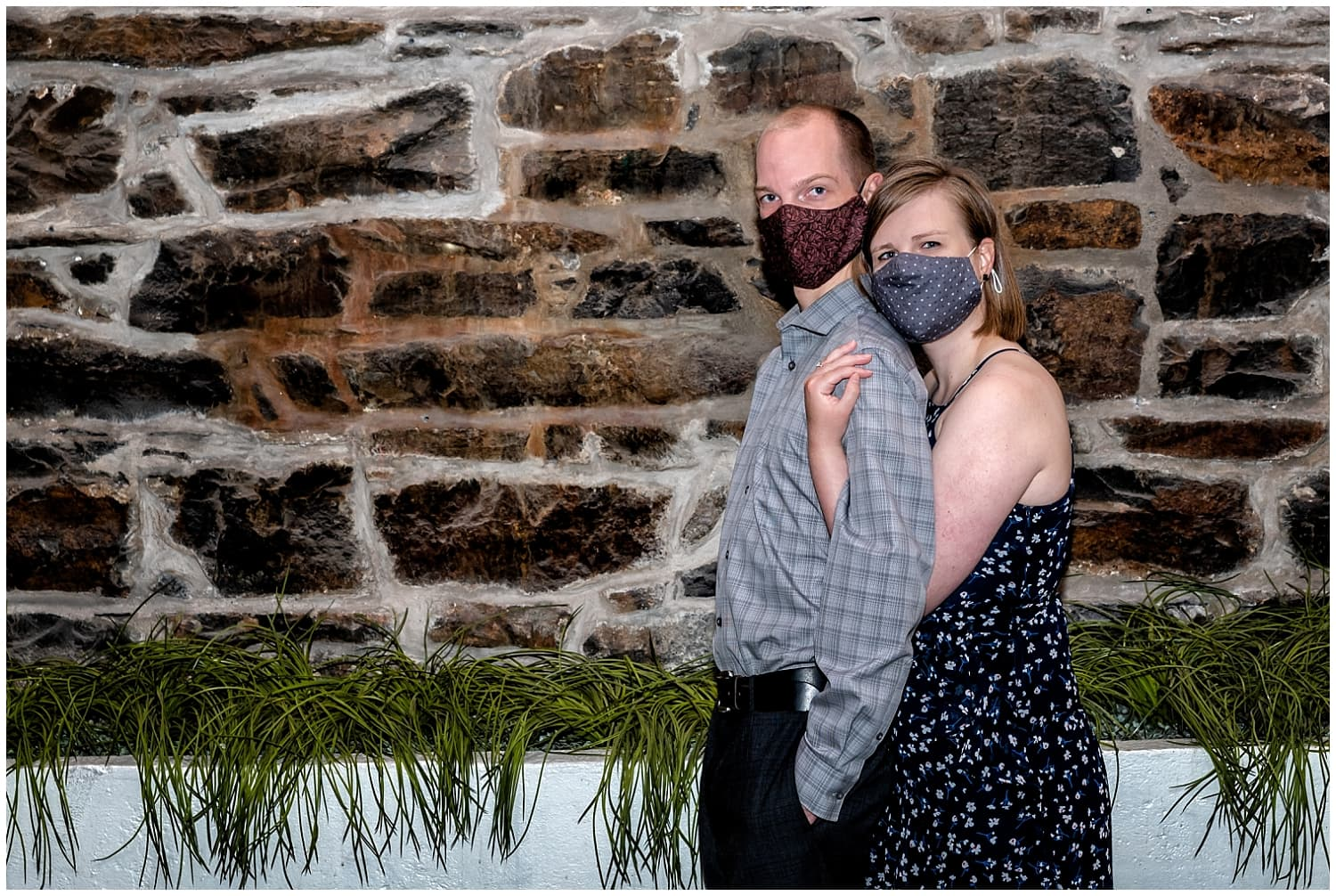 A couple pose for a covid engagement shoot at the Historic Properties in Halifax NS.