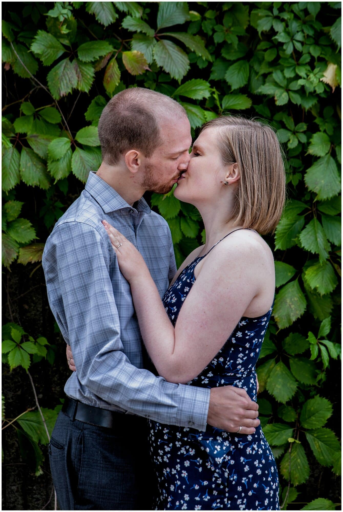 A cute couple kiss during their engagement photos in the Historic Properties in Halifax NS.
