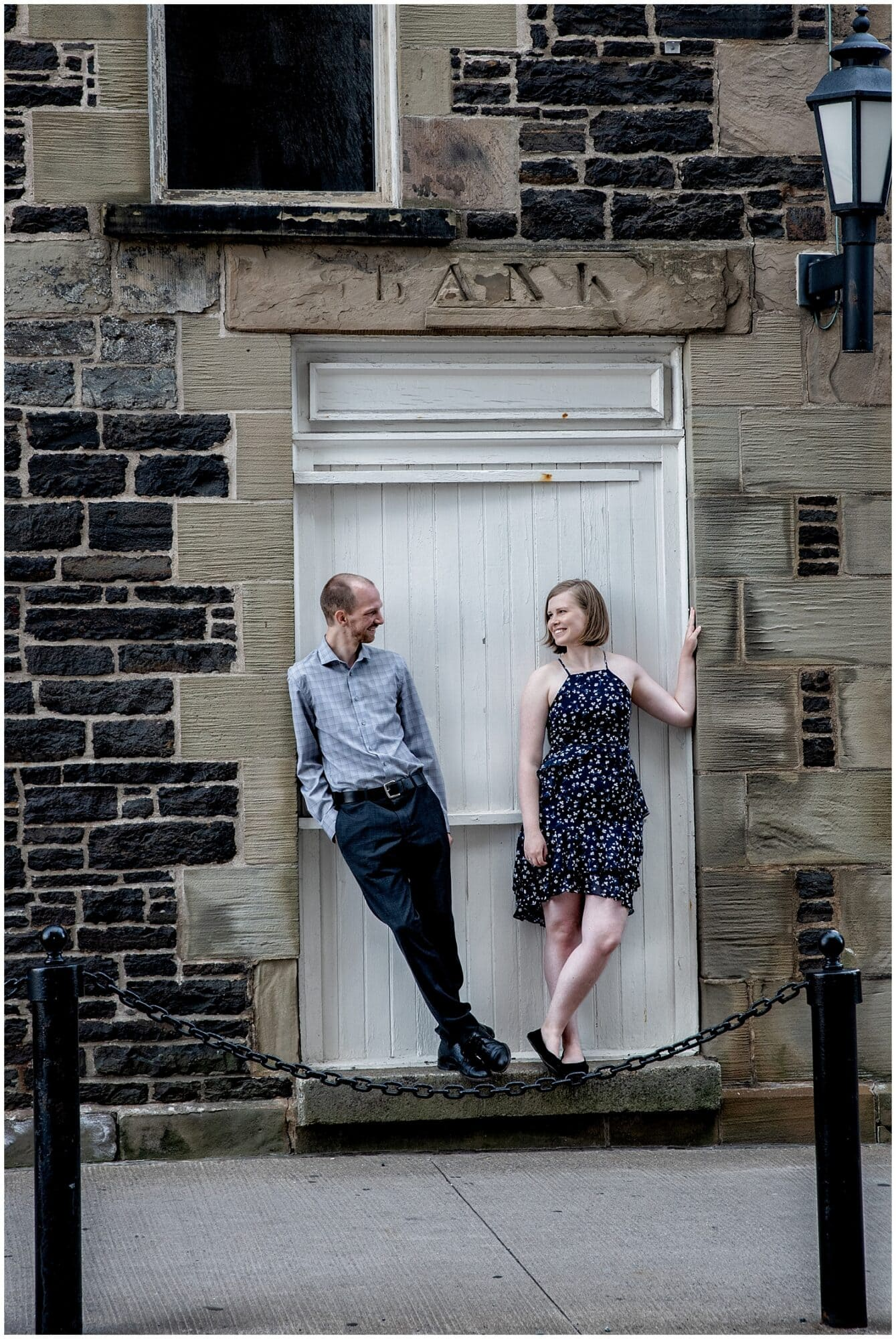 Urban feel engagement photos of a couple in love at the Historic Properties in Halifax NS.