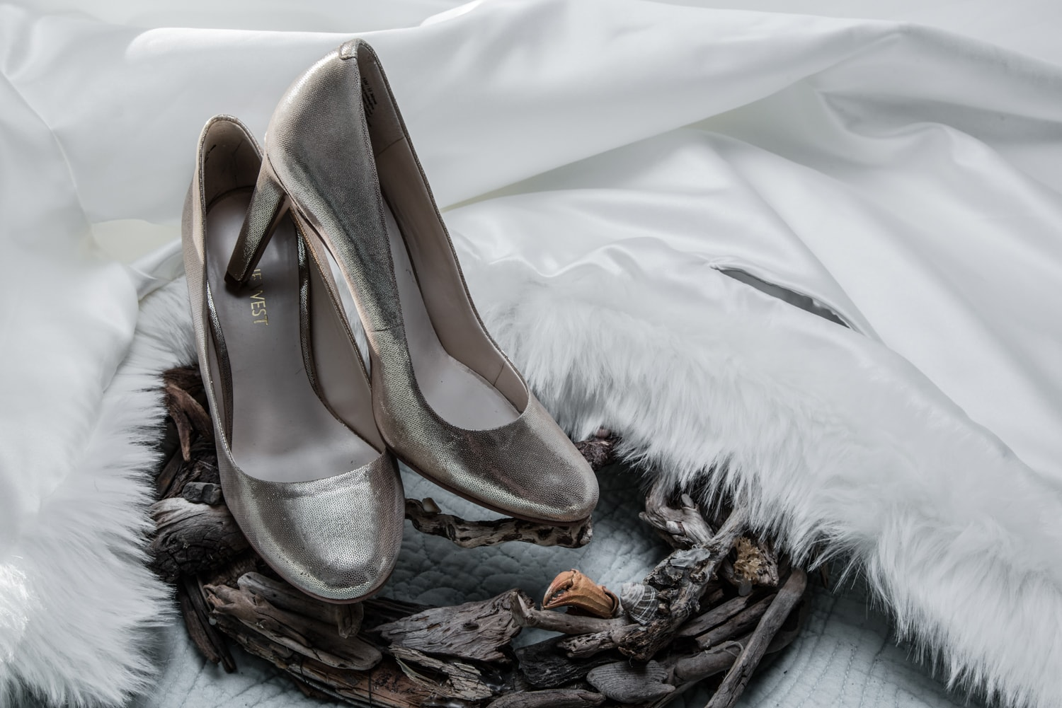 The bride's winter wedding shoes with fur cape.
